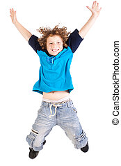 Young and attractive kid jumping high, indoors, isolated...