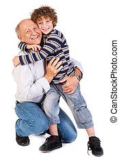 Grandson hugging his grandpa, indoors - Grandson hugging his...