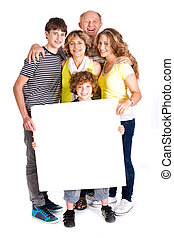 Portrait of a happy family holding a billboard isolated over...