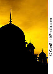 Silhouette of a mosque in sunset.