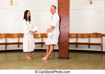 Man and Woman in Spa Recption - A smiling man and woman...