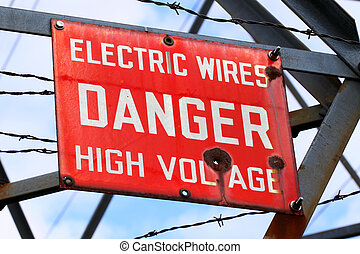 Danger High Voltage Sign - Danger Sign on a powerline tower...