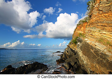 Rugged Tortola Coastline - Jagged rock wall rising from the...