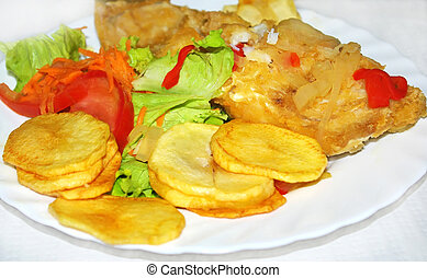 Portuguese plate of salted codfish. - Portuguese plate of...