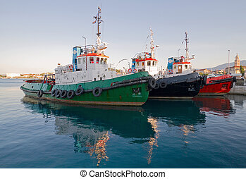 Tugboats - Three tugboats in harbor