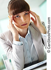Tiredness - Portrait of fatigue businesswoman touching head...