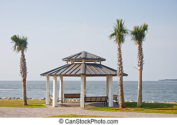 White Pavilion by Coast with Palm Trees