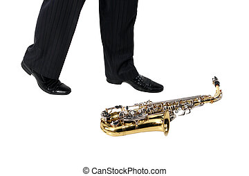 Sax on the floor, men's foot on the white background