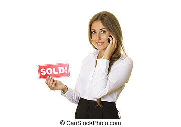 Realtor - Attractive modern business woman talking on the...