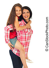 Mother gives piggy back ride to her daughter - Happy mother...