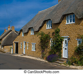 Row of thatched cottages in Abbotsbury, Dorset, England
