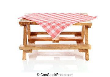 empty picnic table with tablecloth over white background