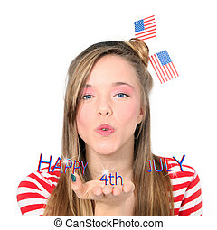 4th july independence day - teen blowing wishes on 4th july...