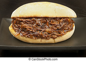 Pulled Pork Sandwich - Close-up of a pulled pork sandwich.