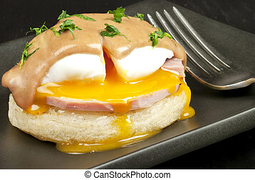 Eggs Benedict - Close-up of eggs benedict made with red wine...