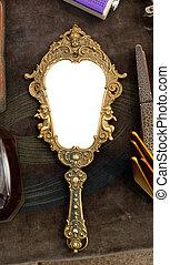 Vintage hand-held mirror