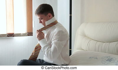Tie a Necktie - man preparing for his day at work