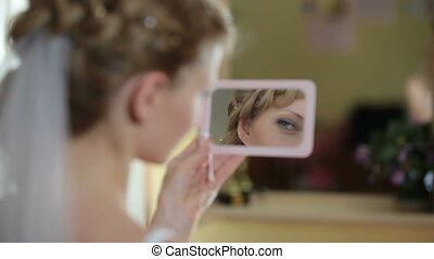 face of bride in  mirror