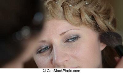 Makeup - girl having makeup applied