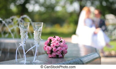 bridal bouquet and two glasses of champagne near the...