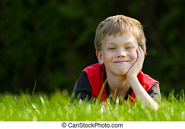 Cute young child in meadow