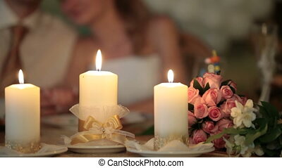 burning candles at the wedding