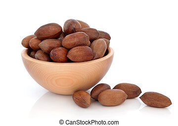 Pecan Nuts - Pecan nuts in a beech wood bowl and loose...