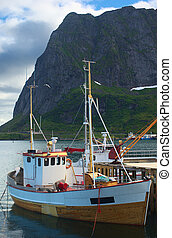 A two-master fishing boat (dogger) anchoring in Reine on...
