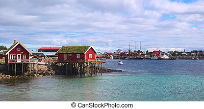 Typical red wooden fisherman's cabins called Rorbu built on...