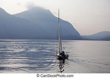 Sailing fishing boat at sunset