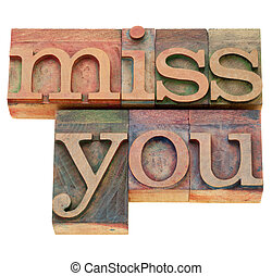 miss you in letterpress type - miss you - isolated words in...