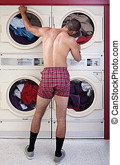 Man in underwear at the dryer - Muscular man in boxer shorts...