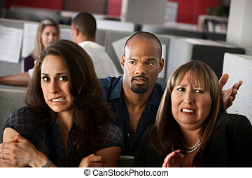 Scared Office Workers - Handsome African-American man stands...