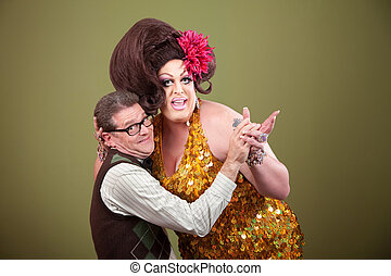 Drag Queen Holding Nerd - Drag queen and Caucasian nerd on...