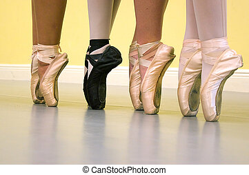 ballet dancers feet in pointe shoes - Four ballerinas are...