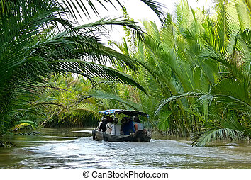 Cruising in the Mekong delta - Boat filled with tourists...