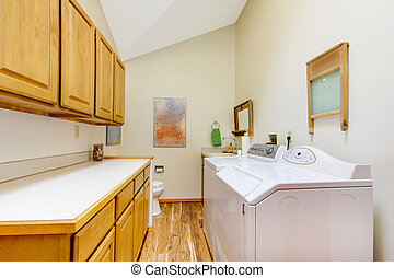 Large laundry room with white washer and dryer