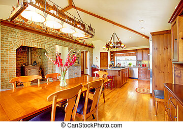 Country large kitchen and dining room with brick stove