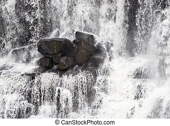 rocks in waterfall