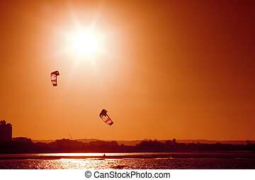 Kite boarders - A pair of kite boarders at sunset