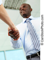 Deal - Businessman handshaking with associate after signing...