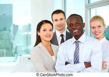 Partners - Group of confident business partners looking at...