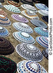 A colorful collection of yarmulkes at Jerusalem market