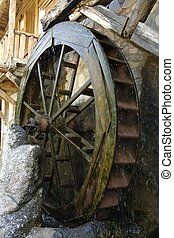 Water mill wheel - rotating wheel of water mill, motion blur...