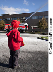 Child 3 years old looking at a fire engine