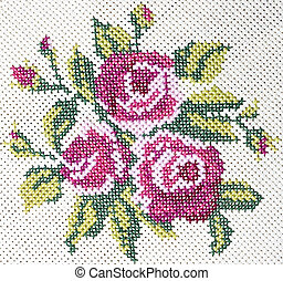 Old cross stitch embroidery of rose and leaves