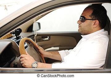 Arabic man driving a car