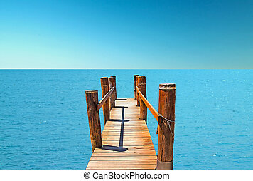 Pier - A wooden pier pointing to the deep sea