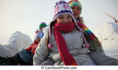 Ice-run - Happy family having fun outside in winter