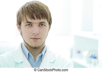 Portrait of young researcher in the lab, hospital worker